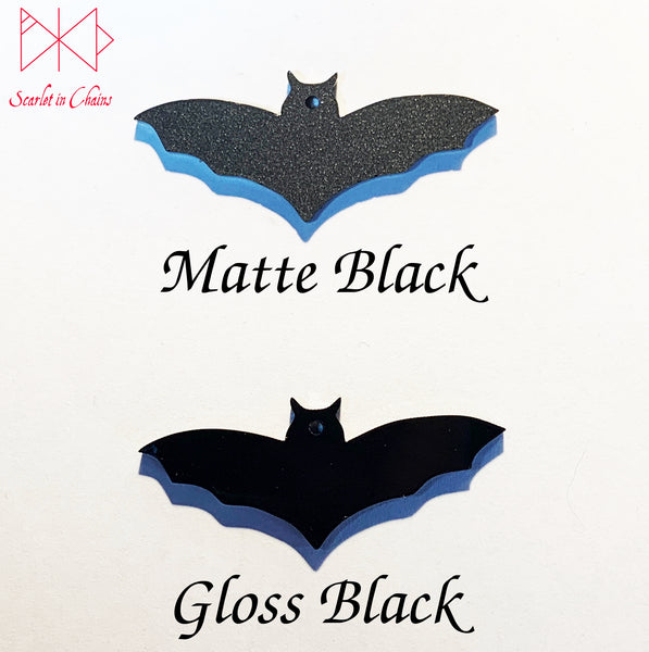 perspex bats showing the difference between matte black and gloss black