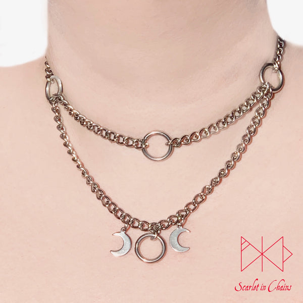 Layered stainless steel chain choker necklace with o ring choker section at the top and the goddess necklace at the base. worn
