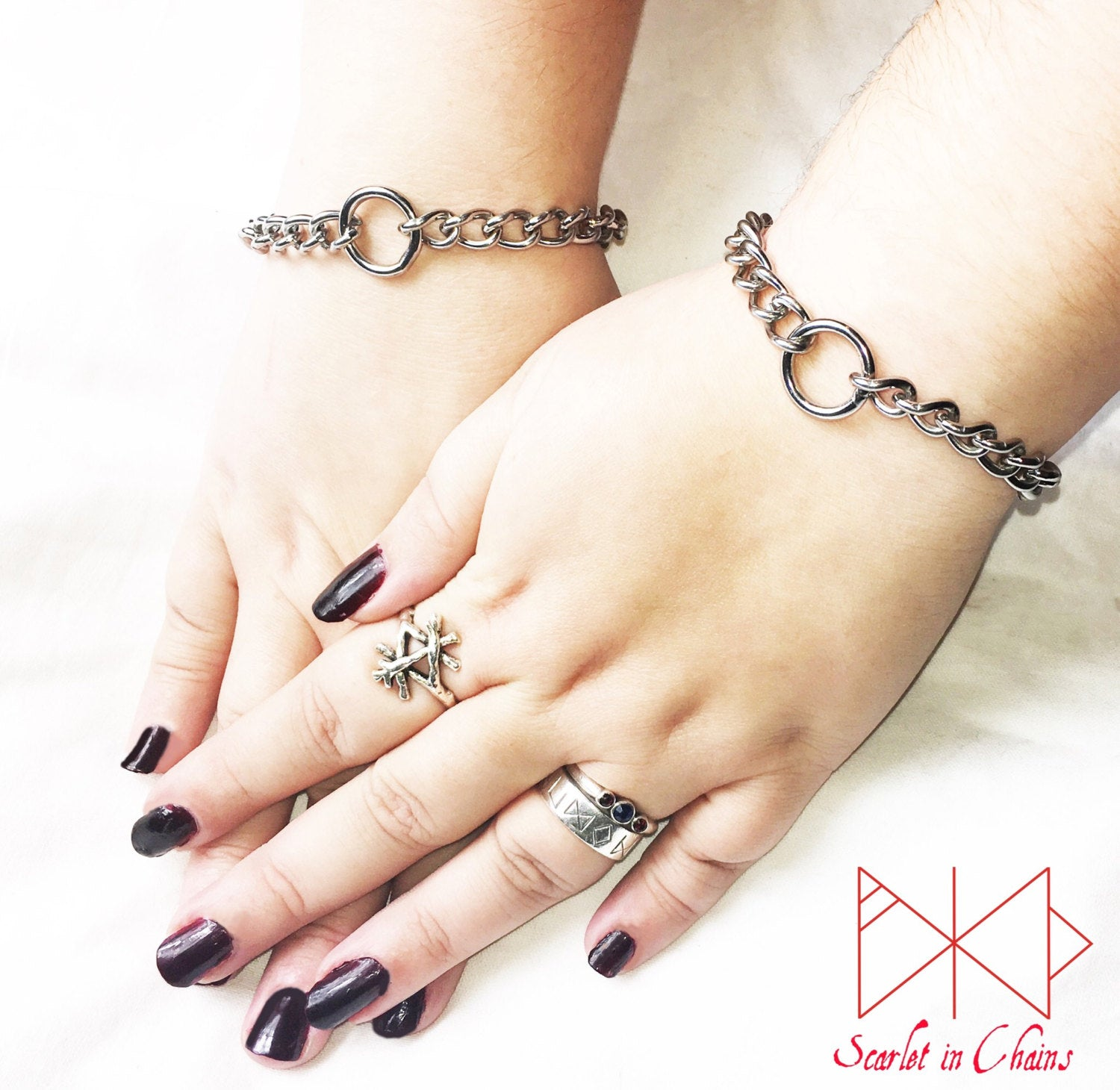 Pair of mini Luna cuffs worn, stainless steel mini chain cuffs with a central O ring
