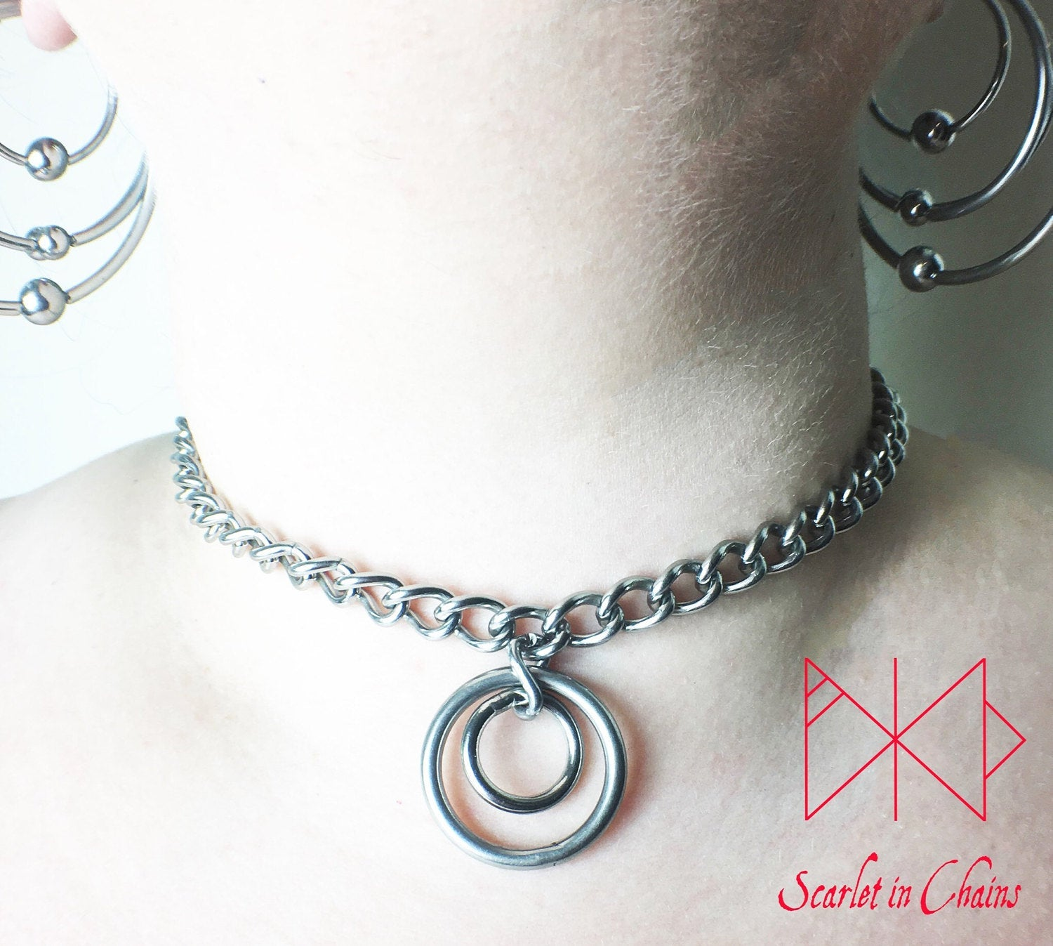 Stainless steel chain choker with a double stainless steel O ring pendant which consists of a smaller o ring inside a larger one. worn