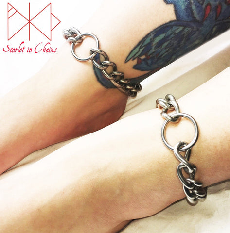 worn shot of a pair of luna anklets large stainless steel chain anklets with a n O ring