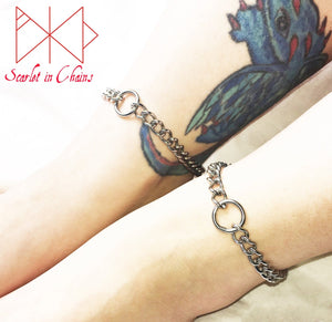 worn shot of mini luna anklets, stainless steel chain with o ring at its centre