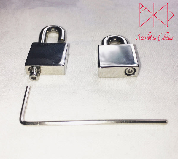 close up of base of stainless steel padlock