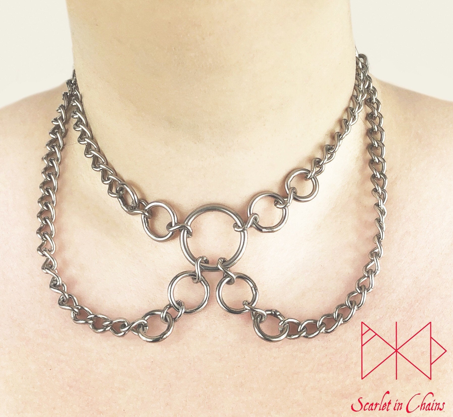 worn shot of synergy collar, stainless steel chain double layer collar