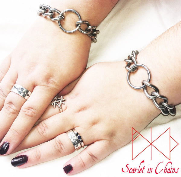 Stainless steel chain wrist cuffs with stainless O ring at its centre.