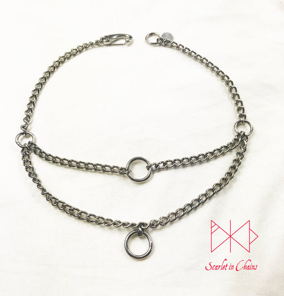 flat shot of micro stainless steel chain multi layer luna rockstar choker finished with a stainless steel clip