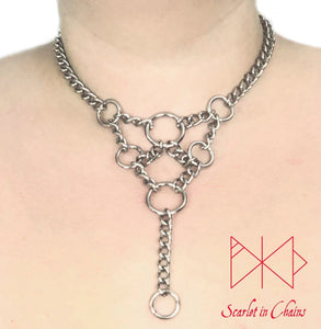 worn shot of summoner collar stainless steel chain collar with geometric style design with chain and O rings
