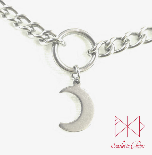close up of stainless steel crescent moon charm on choker