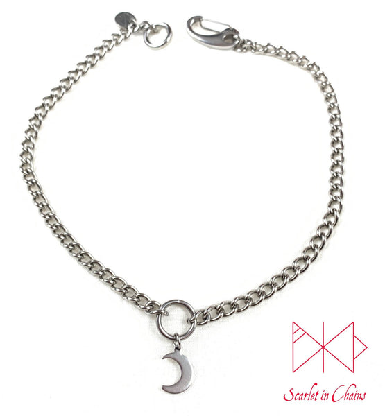 stainless steel chain O ring choker with stainless steel crescent moon charm. finished with a stainless steel clip flat shot