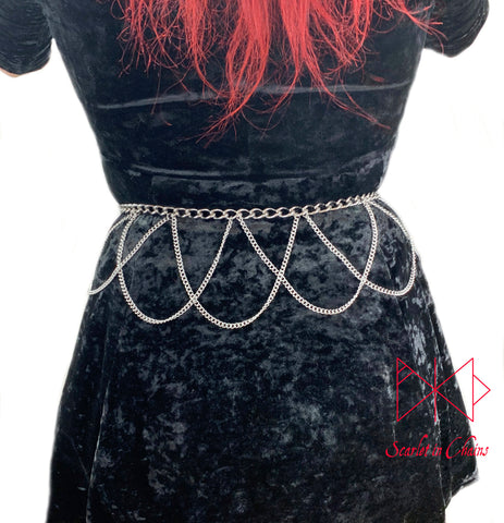 Countess belt worn, Stainless steel chain belt with thinner stainless steel chain loops hanging from it in a lace style pattern