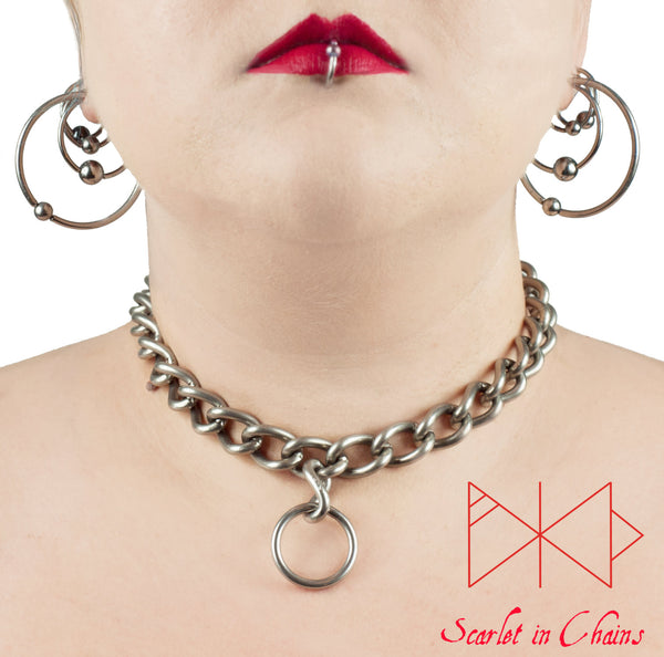 Worn shot of Rockstar collar, stainless steel chain collar with a central O ring pendant