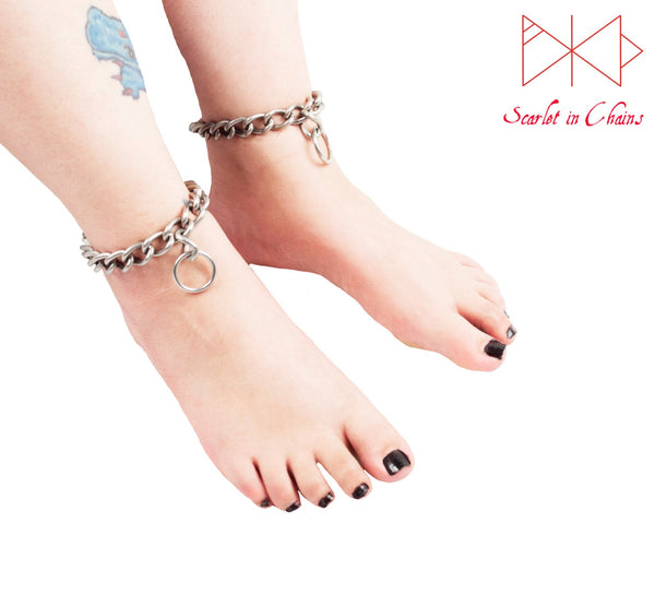 worn shot of a pair of Rockstar Anklets, large chain anklets with an O ring pendant at their center