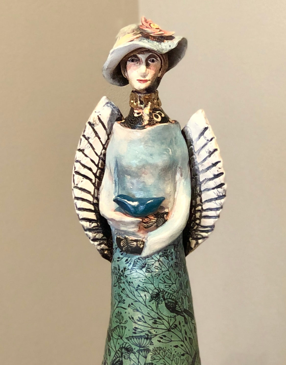 Tall Ceramic Angel with Bird and Gold Lustre