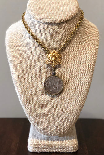 Vintage Brazilian coin on vintage chain