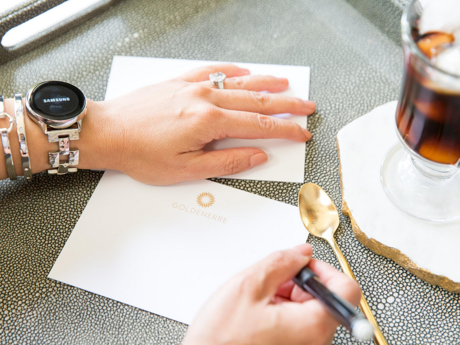 Silver hammered bracelet watch band for the Samsung  watch, shown with woman writing letter on Goldenerre stationery with gold spoon and coffee on an agate coaster