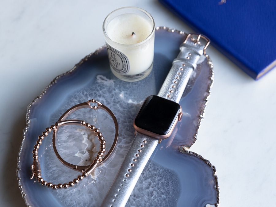 Stylish apple watch band tableau - luxe metallic silver leather band for the apple watch, shown on a rose gold apple watch on a blue agate tray. Goldenerre matching bracelets featured - Rose gold beaded bracelet and rose gold classic link bracelet.