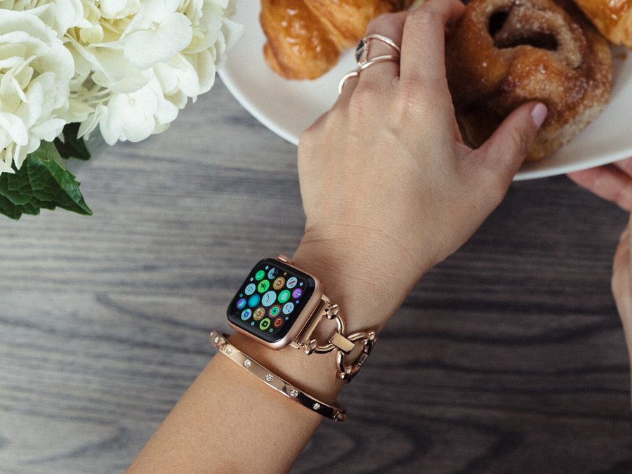 rose gold rhinestone bracelet with our rose gold classic link watch band for the Apple Watch, reaching for breakfast treats