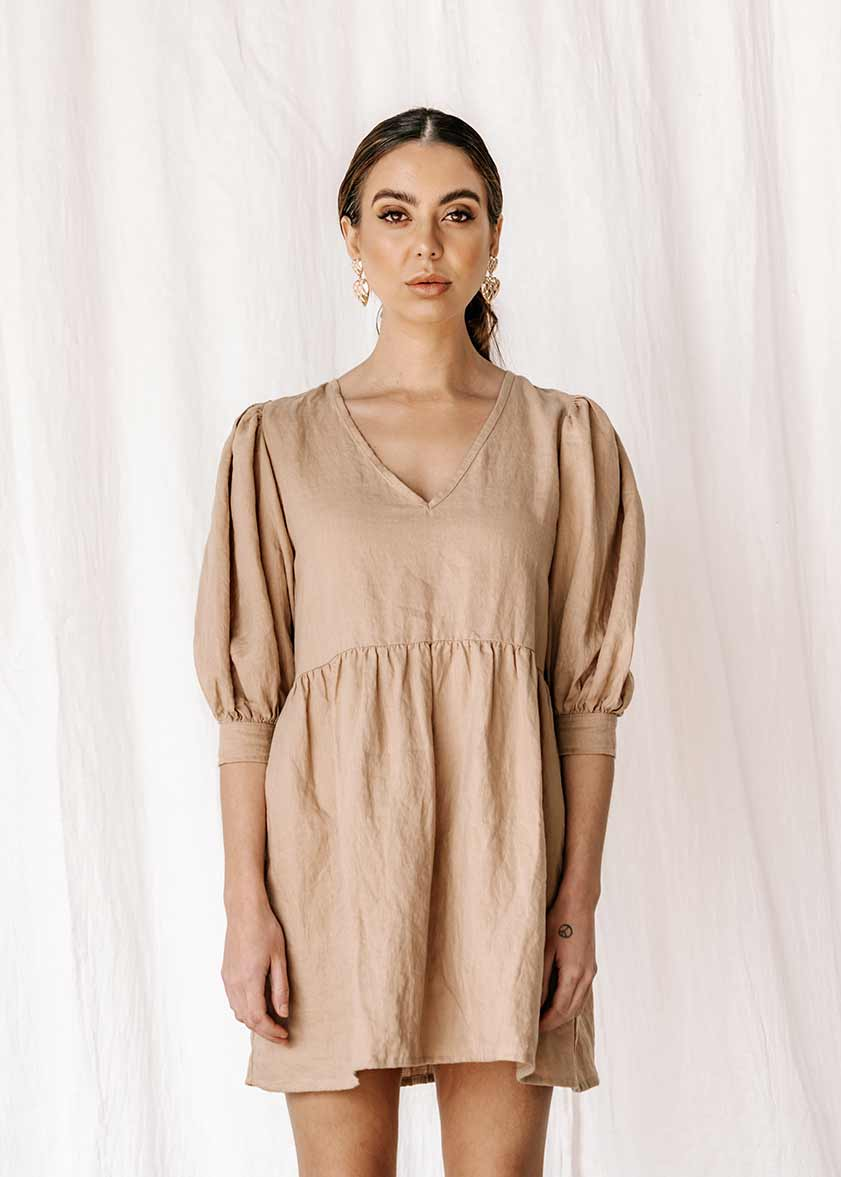 womens v neck smock made from 100% highest quality linen. A flattering cut with an adjustable back tie. Puffy 3/4 sleeves & a drop waist. Comfortable & classy allowing you to go effortlessly from day to night.