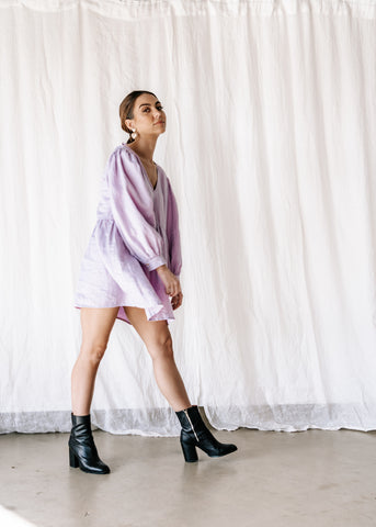 100% linen smock dress with v front. Comfortable, cool & versatile. Exclusively dyed linen in lilac. Ethically made in indonesia.