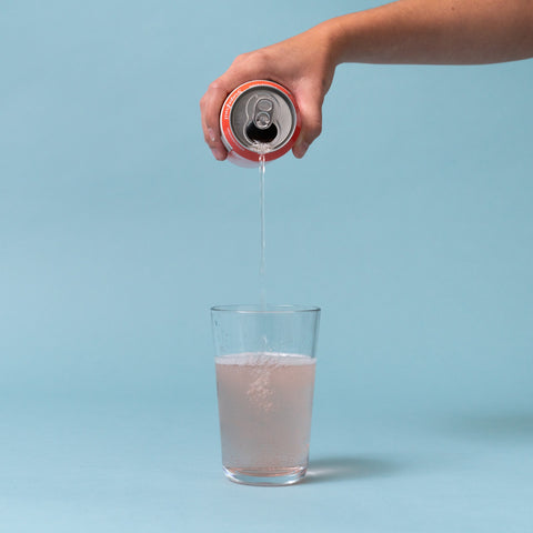 grapefruit soda being poured into a glass