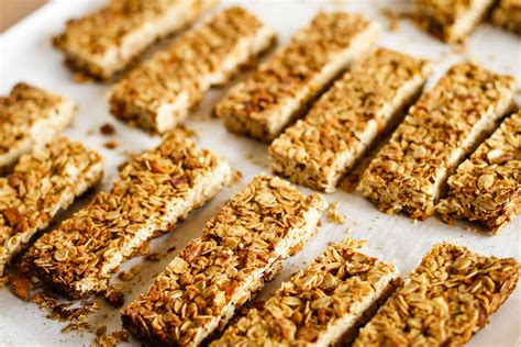 granola bars made with oats are cut and sitting on a pan