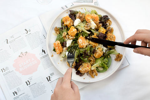 superfood salad being eaten over a calendar