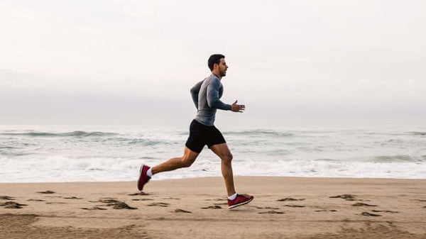 man jogging on sea side to absorb negative ions