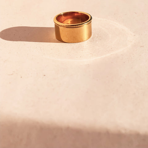 Ring laying flat on tile in the sun