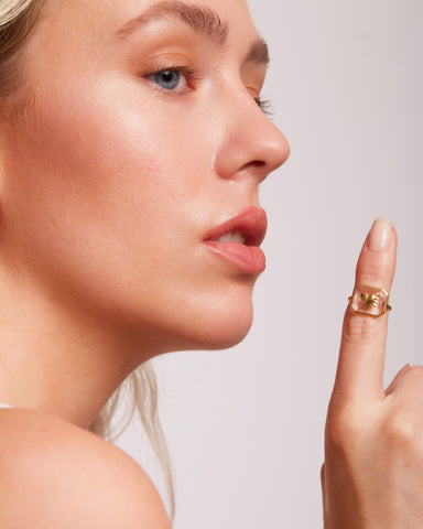 Model with ring extended on finger