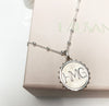 Silver Initial Coin Necklace with beaded chain flat lay lifestyle