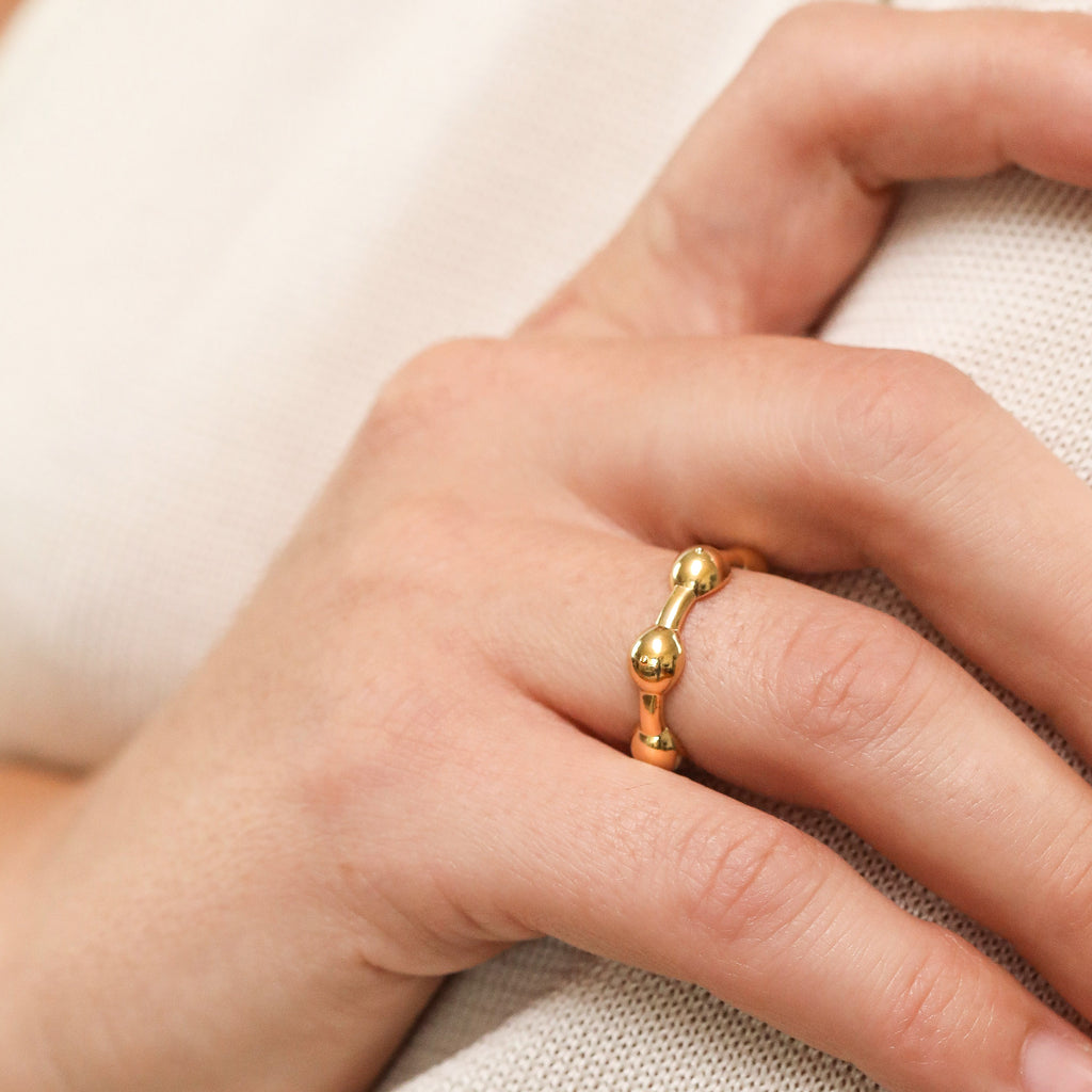 Gold Seeded Eternity Ring on model's hand close up