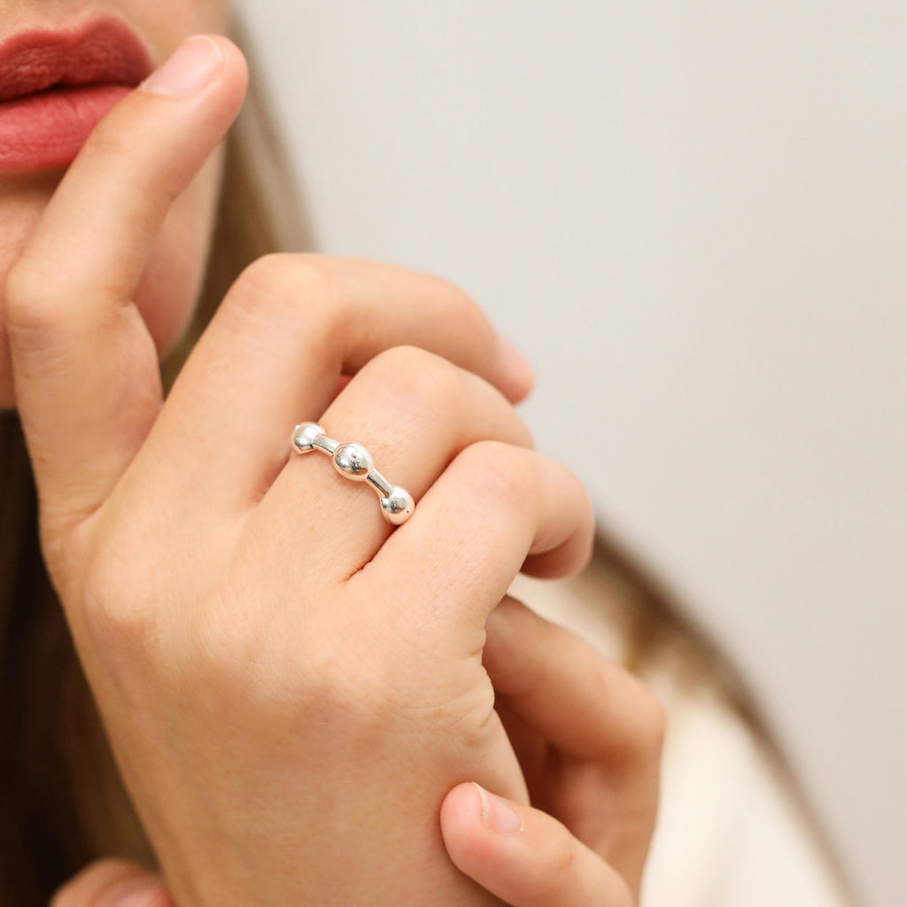 Silver Seeded Eternity Ring on models hand