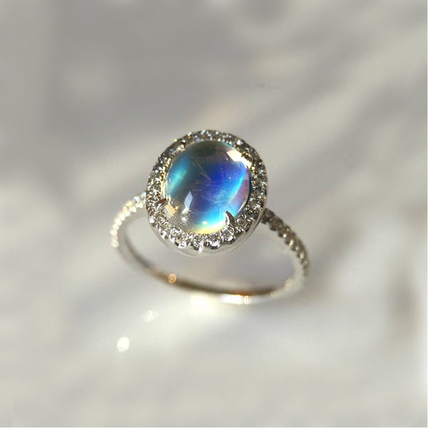 18 karat white gold, Moonstone and diamond halo ring
