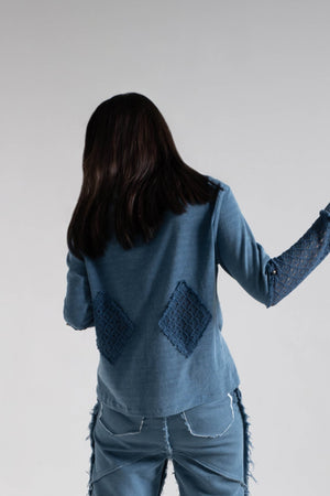 Diamond patched indigo knit top