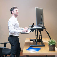 "Load image into Gallery viewer, FlexiSpot Stand Up Desk Converter -28 Inches Standing Desk Riser with Deep Keyboard Tray for Laptop (28"", Black, M7B)"
