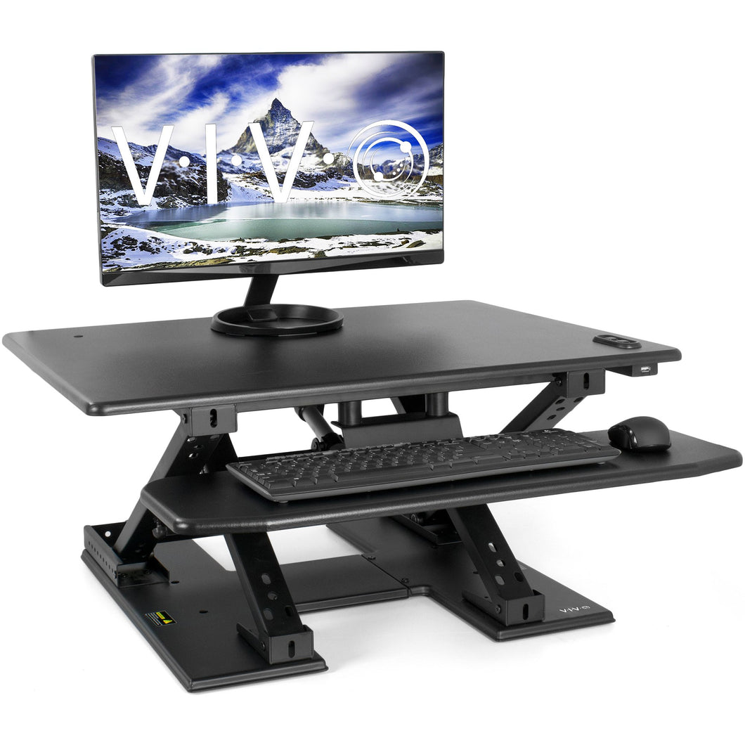 Black Electric Extra Wide 42 inch Stand Up Desk Converter | Quick Sit to Stand Tabletop Dual Monitor Riser Workstation-V00EE