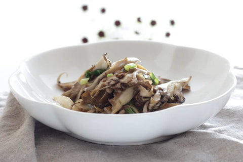Cooked Maitake mushroom in a white bowl, a Japanese meal
