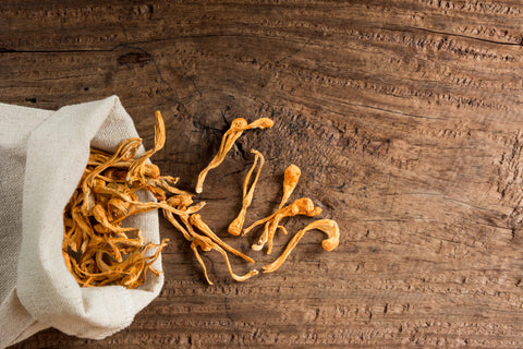 A bag of cordyceps on a wooden table
