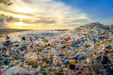 A pile of plastic garbage against a blue sky