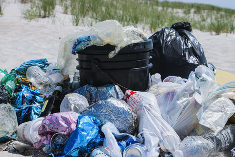 A pile of garbage on a beach - yuck!