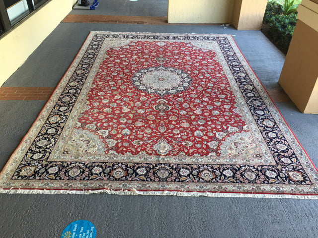 RUG MADE OF WOOL AND SILK RED, BLACK AND TAUPE 16' x 11'