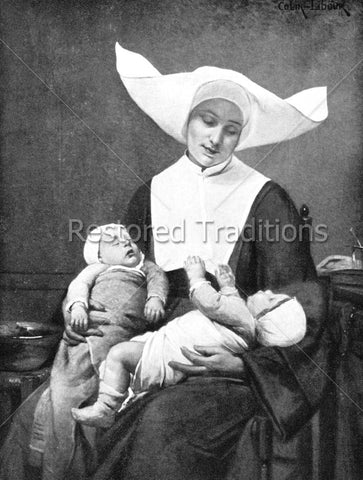 Religious Sister holds babies