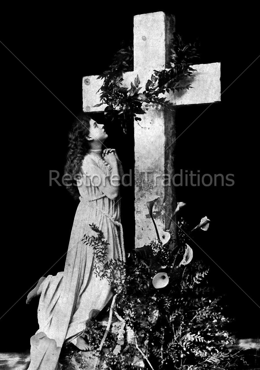 Girl Prays Beneath Cross