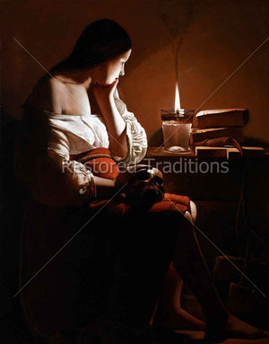 Woman sitting beside candle