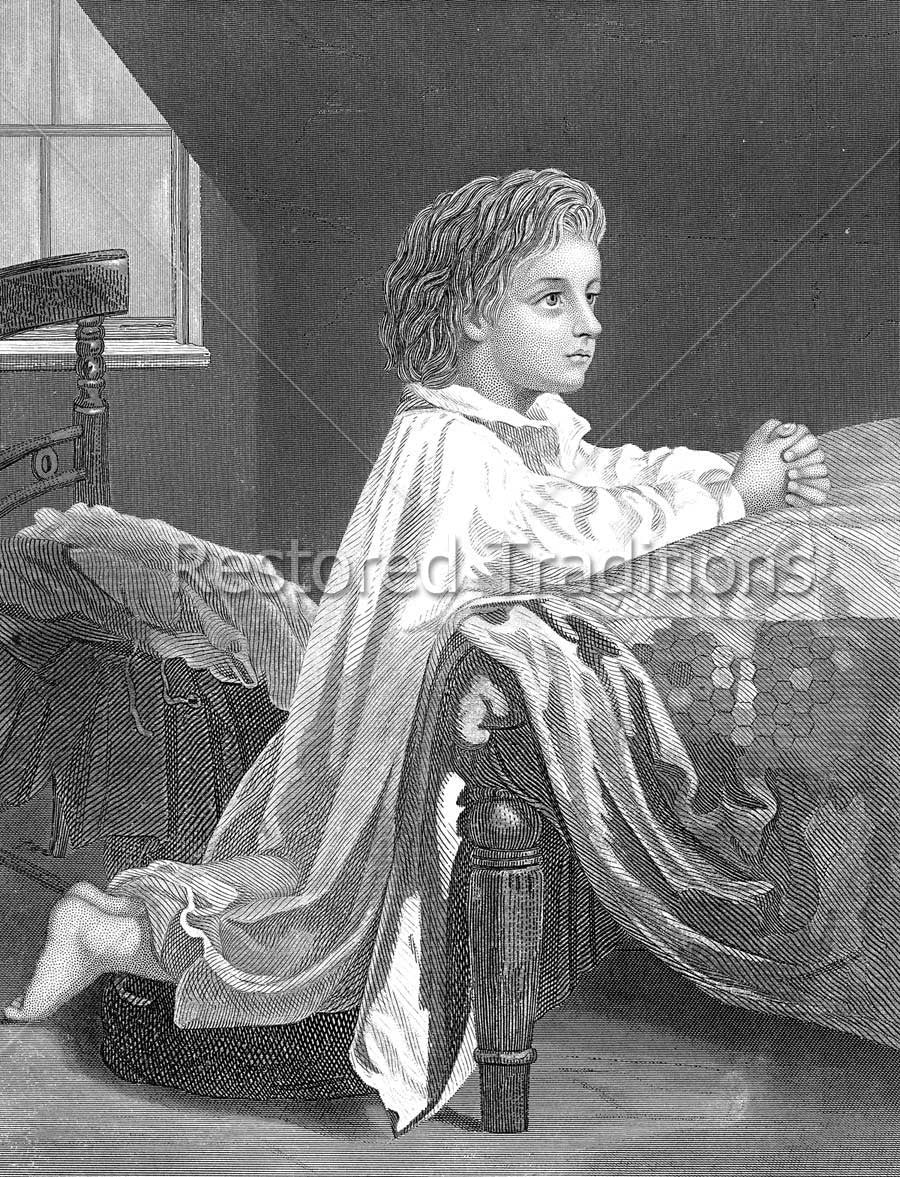 Child praying by bed