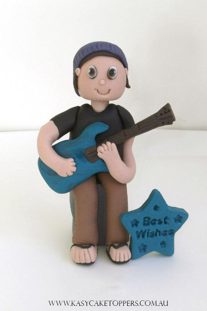 A Guitar Player Cake Topper