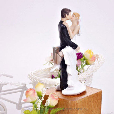 """Groom Kissing Bride"" Resin Figurine Wedding Cake Topper"