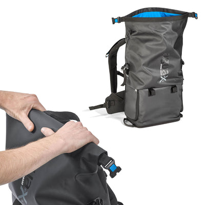 To seal the upper compartment, simply roll the top towards the back of the bag until reaching the dotted line. Then, connect the two side buckles and lock them if needed. Your gear will be kept safe and dry.