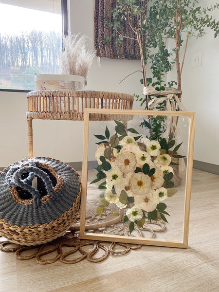 Pressed wedding bouquet in natural wood float frame