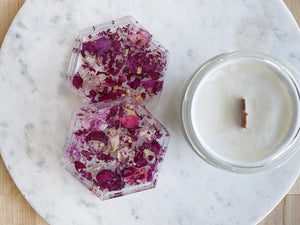 Pink petal resin coaster set with candle.